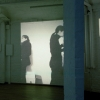 <em>Slang is signing is signals</em>, 2009<br> 3 channel slide projection<br> black and white and color slides<br> Installation view, Souterrain, Berlin