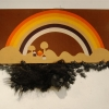 <em>Ova the Rainbow</em>, 2010 <br> Plaster, paint, and plastic roaches on found canvas <br> 4 feet x 1 foot 10 inches