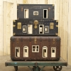 <em>Mobile Home</em>, 2012<br> Vintage suitcases, dollhouse doors and windows, and industrial wagon<br> 58 x 48.5 x 30.5 inches