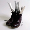 <em>Suicide Division</em>, 2009<br> Red wings leathershoes, 14 kitchen knives, sugar<br> 13.8 x 10.2 x 15 inches