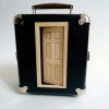 <em>The Worldhaters Homesick Blues</em>, 20009<br> Vintage suitcase, doll house inside (6 panels)<br> 8.3 x 9.8 x 5.1 inches