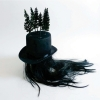 <em>Storm Hat</em>, 2009<br> Cylinder hat, model trees, spray paint, balsa wood, black wig<br> 21.7 x 13.8 x 19.7 inches